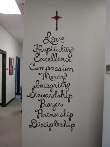 Behind the scenes at Siloam Family Health Center, the staff is reminded of the facility's mission.
