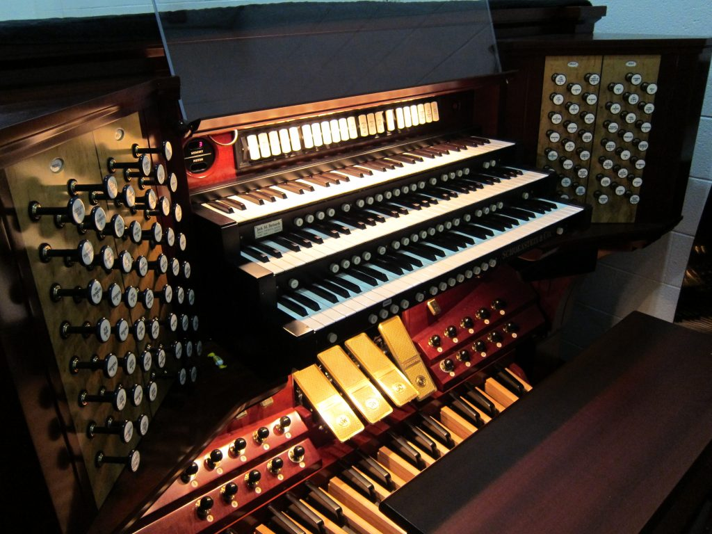 Even with some electronic help, playing the organ still means a lot of hand-eye-foot coordination.