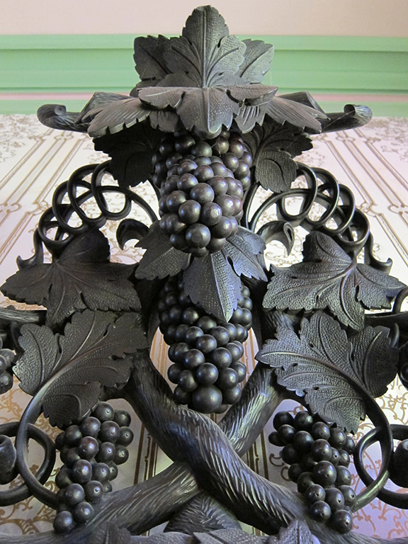 The intricately carved front hallway mantle. Check out the detail of those grapes.