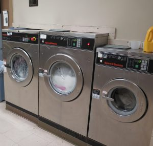Laundry is an all-day affair at Community Care Fellowship, where hundreds of pounds are washed each day.