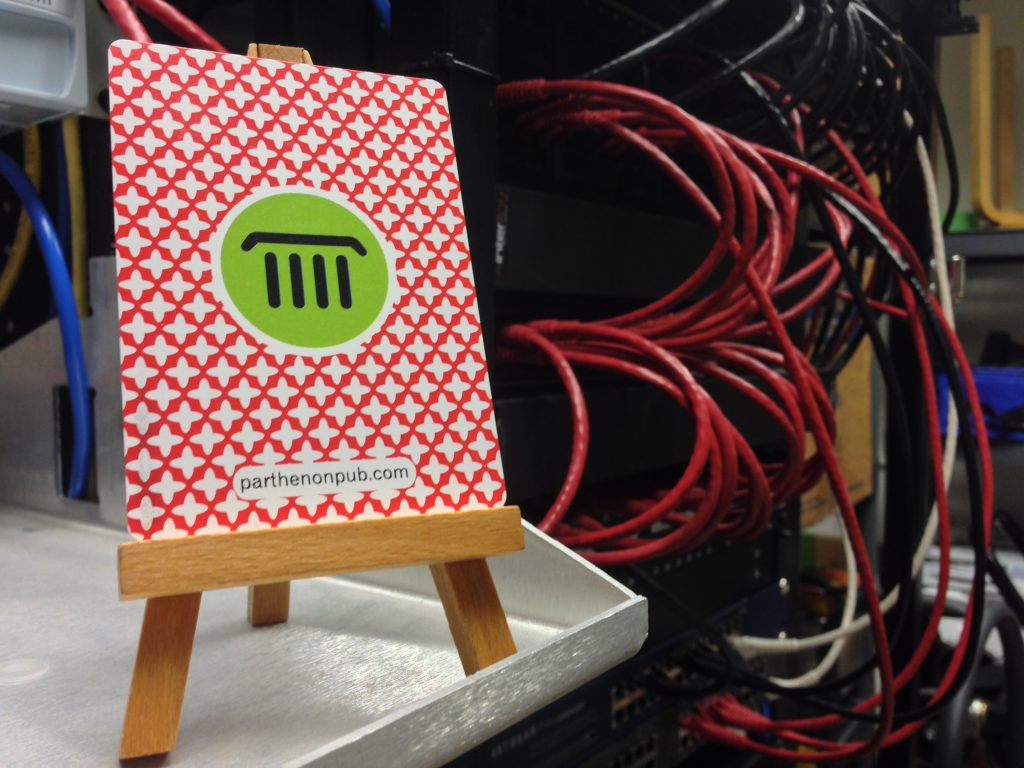 parthenon logo on an easel with cables behind it