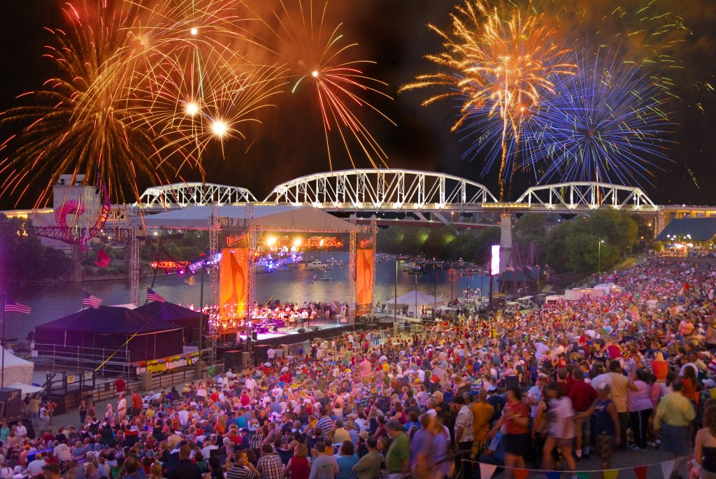 a crowd watches fireworks in Nashville TN on July 4