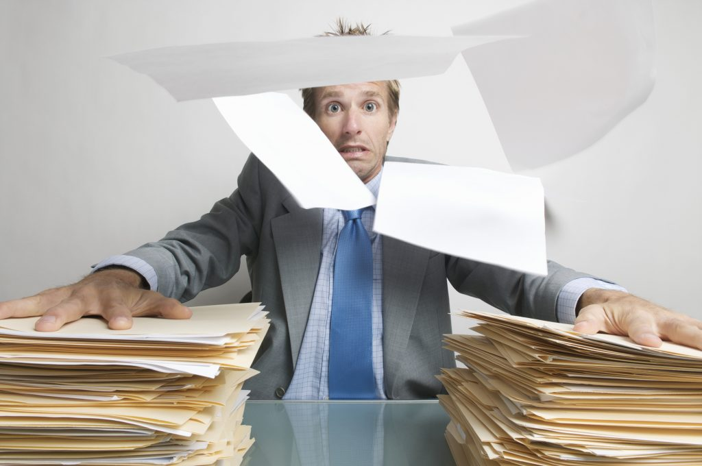 Office Worker Holds On to his Paperwork