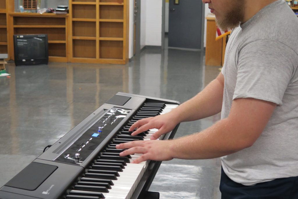 Teen boy playing keyboard at Woodland Hills Detention Center