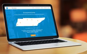 Launch Tennessee website on a laptop