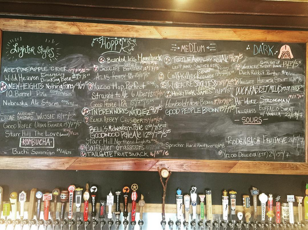taps and chalk board at craft beer store the filling station