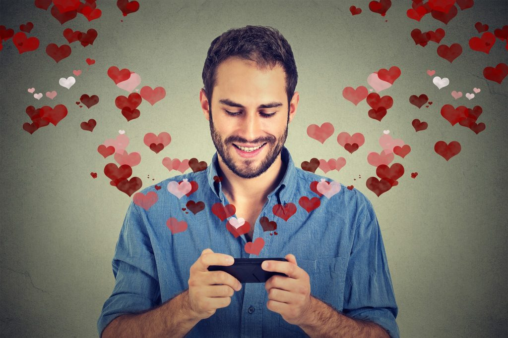 Man looking with love at mobile phone screen