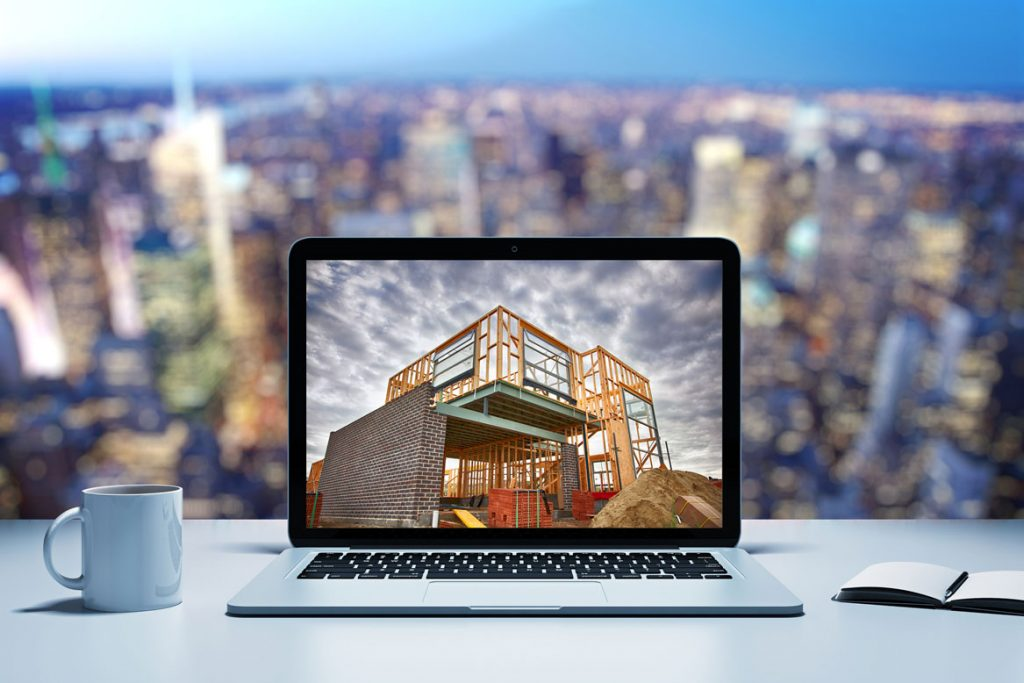 Home construction image on a laptop screen