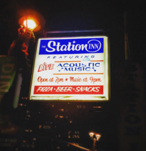 sign outside station inn