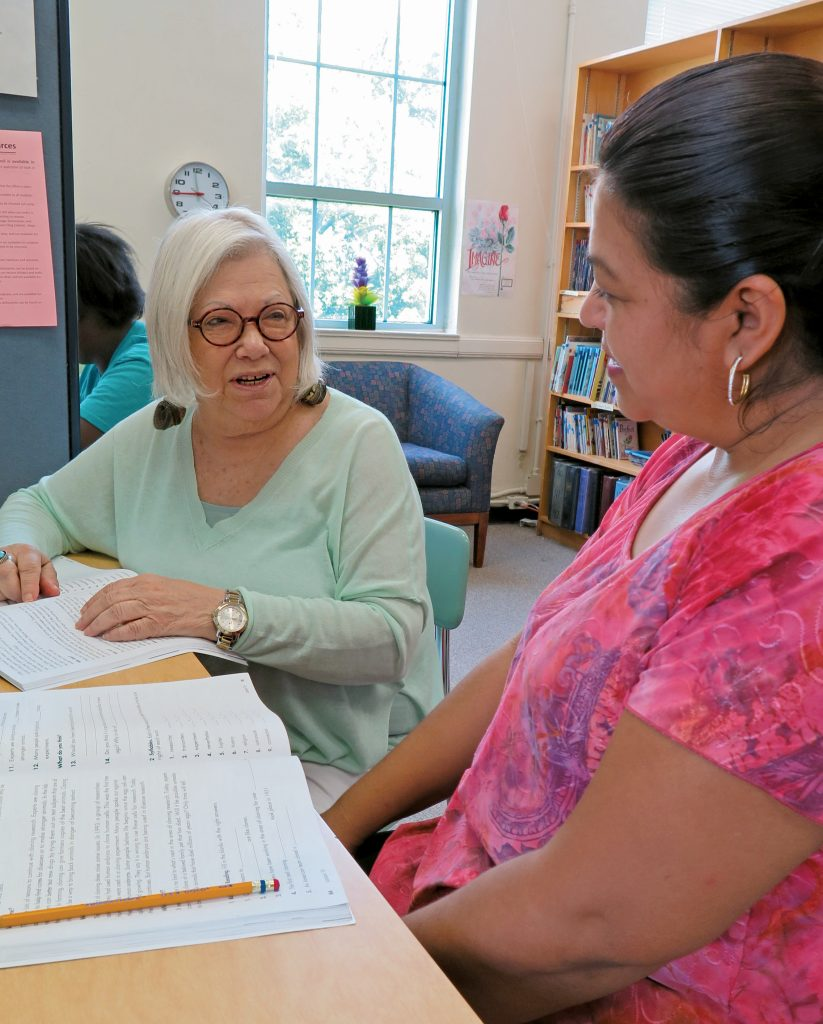 Sheila Jacobs helping a student with homework in the Nashville Adult Literacy Council office.