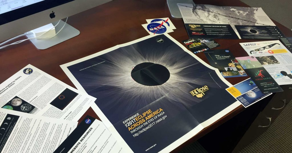 A NASA eclipse folder and pages of information