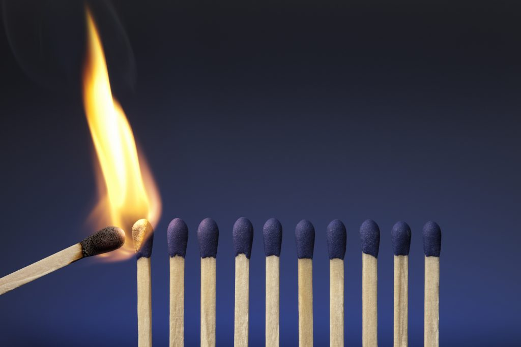 thought leadership illustrated as a lit match in a row of unlit matches