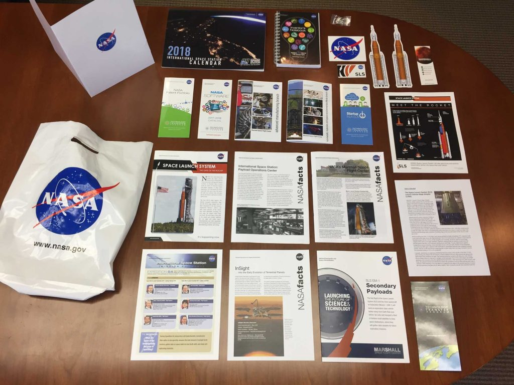All of the materials NASA sent social media influcencers with are laid out on the table.