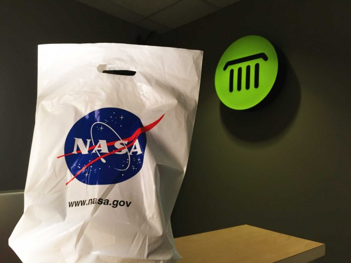 A NASA-branded plastic bag of promotional materials